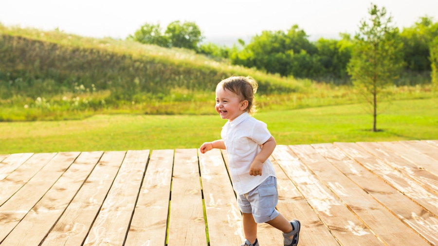 Summer, childhood and baby concept - little boy having fun in summer nature