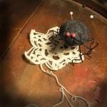 puntaspilli a forma di ragno