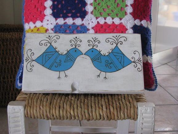 uccellini dipinti su legno