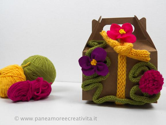 scatola di cartone con caterinette di lana