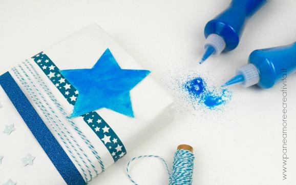 regalo con stella e sabbiarelli-link