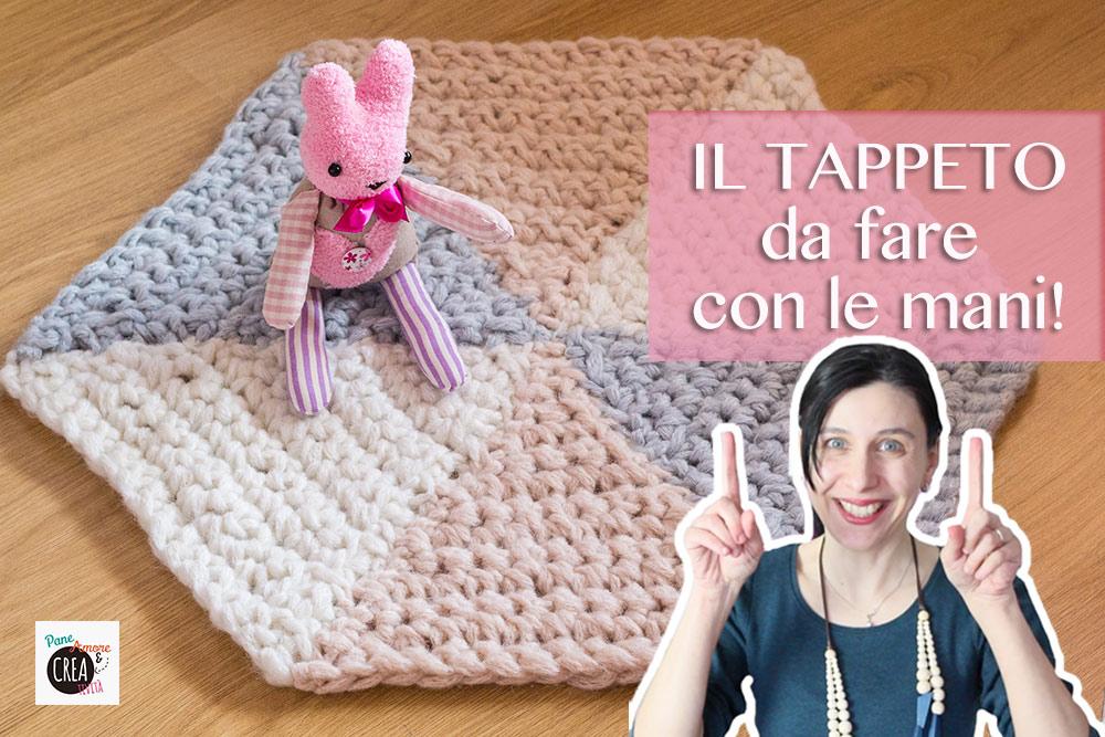 tappeto-con-le-mani