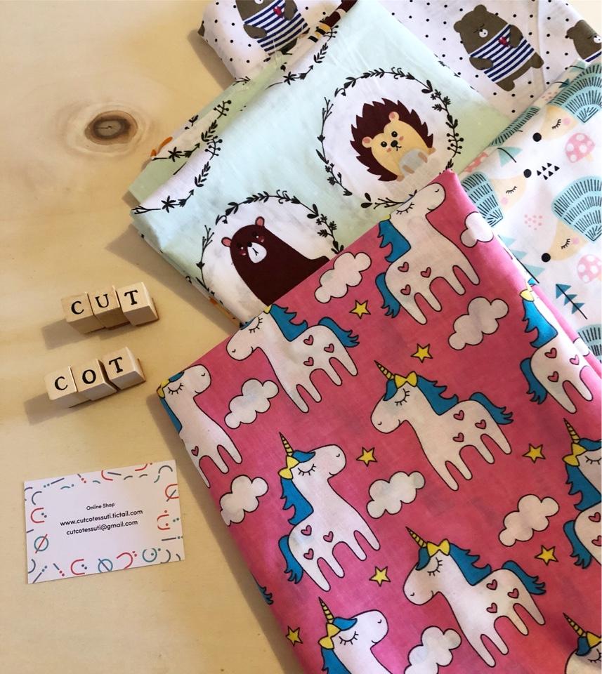 cutcot tessuti con unicorni
